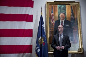 "A security guard stands near a portrait of former U.S. President Ronald Reagan as Senator Ted Cruz, a Republican from Texas and 2016 presidential candidate, not pictured, speaks during the ""Wisconsin Decides 2016"" hosted by Republican Party of Milwaukee in Milwaukee, Wisconsin, on Friday, April 1, 2016. After months of tense dealings with Republican presidential front-runner Donald Trump, the Republican National Committee's biggest challenge is beginning to take shape: how to navigate a scenario in which Trump leads his challengers in votes and delegates heading into the convention, but loses the nomination. Photographer: Daniel Acker/Bloomberg"
